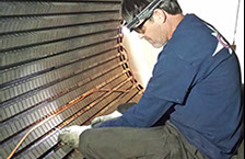A GTS employee working on the wedges of a stator. Click here to continue to the Generator Inspections page.
